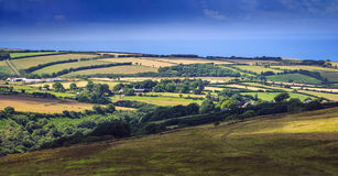 Hills and pastures in Exmoor. On the horizon is seen sea. North Devon. UK Stock Photos