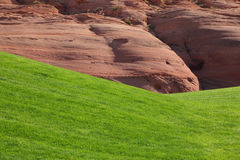 Hills from red sandstone and green grassy hills Stock Photos