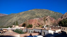Hills and roof of some houses in the village of Purmamarca, Juju. Purmamarca is a town located in the canyon Quebrada de Humahuaca in Jujuy, Argentina, known for stock photos