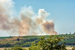 Great field fire over the hills of a rural Region stock photos