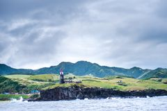 Hills of Sabtang Island with Lighthouse fronting the shore at, Batanes, Philippines.  royalty free stock photo