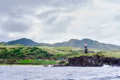 Hills of Sabtang Island with Lighthouse fronting the shore at, Batanes, Philippines.  stock photography