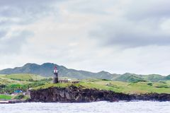 Hills of Sabtang Island with Lighthouse fronting the shore at, Batanes, Philippines.  stock images