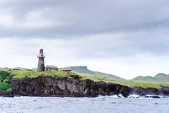 Hills of Sabtang Island with Lighthouse fronting the shore at, Batanes, Philippines.  stock image
