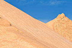 Hills of sand and stone gives Royalty Free Stock Images