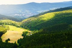 Hills and sunny valley in the Stone Mountains. Vast panorama of picturesque countryside landscape in Sudetes, Poland. Aerial view. Hills and sunny valley in the stock photography