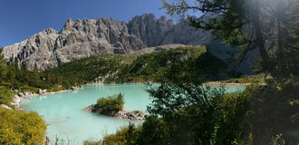 Hills surrounding Lake Sorapis, Dolomites, Italy. Rocky hillside around Lake Sorapis in Dolomites Mountains of Italy on sunny day with blue skies Stock Photos