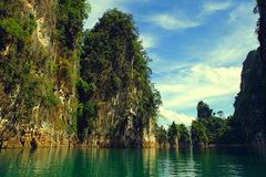 The hills in Thailand. The emerald ocean is surrounded by hills Royalty Free Stock Photos
