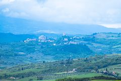 The landscape of Val d`Orcia, Tuscany, Italy. Hills of Tuscany. Val d`Orcia landscape in spring. Cypresses, hills and green meadows stock image