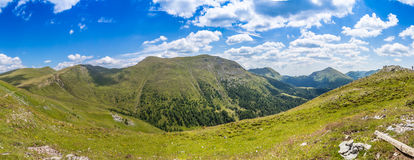 Hills and valleys. With cloudy sky Royalty Free Stock Photos