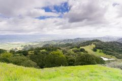 Hills and valleys in Rancho Canada del Oro Open Space Preserve on a stormy spring day, California stock image