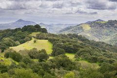 Hills and valleys in Rancho Canada del Oro Open Space Preserve on a stormy spring day, California royalty free stock photos