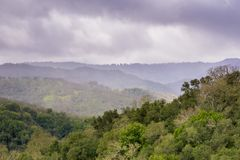 Hills and valleys in Rancho Canada del Oro Open Space Preserve on a stormy spring day, California stock photography