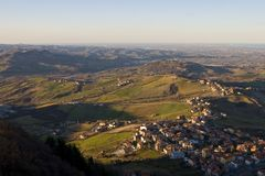 Hills and villages unther sunset Stock Image