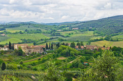 Hills, vineyards and cypress trees, Tuscany landscape near San Gimignano Stock Images