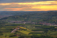 Hills and vineyards at sunrise in Italy. Stock Photos