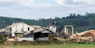 Lumber processing factory with an excavator royalty free stock photos