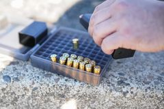 Luger handgun bullets with a magazine at the gun range. stock image