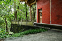 Hillside ancient Chinese building with balustrade in woods Royalty Free Stock Image