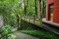 Hillside ancient Chinese building and steps in summer woods Stock Image