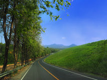 Hillside asphalt road to mountain Royalty Free Stock Photography