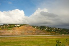 A hillside in the caribbean cut to accommodate a runway. The start of a new landing strip on the island of st. vincent in the windward islands Stock Photography