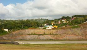 A hillside in the caribbean cut to accommodate a runway. The start of a new landing strip on the island of st. vincent in the windward islands Stock Photos