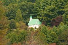 Hillside church. Church on a wooded hillside stock photos