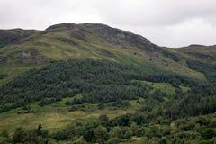 Hillside des montagnes écossais un jour obscurci Images stock