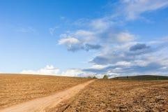 Hillside Dirt Road Landscape Stock Photography