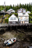 Hillside houses on banks of river ay Ketchikan Stock Image