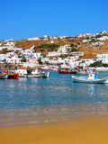 Hillside houses and boat harbour in Mykonos Royalty Free Stock Images