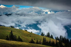 Hillside and mountains obscured by clouds  Stock Photos