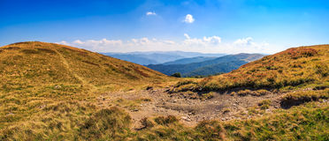 Hillside panorama in mountains with path uphill Stock Photography