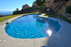 Hillside pool Calahonda Spain. Bright sunny view of a pool on a hillside apartment complex on the Costa del Sol Spain Royalty Free Stock Photography