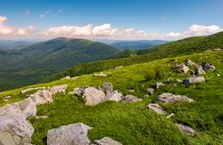 Hillside of Runa mountain in summer. Beautiful landscape with huge boulders in grass Stock Images