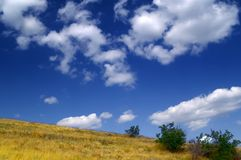 Hillside and sky. With clouds Stock Images