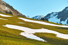Hillside snow patches Stock Image