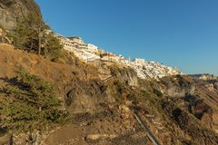 Hillside view from the cable car with sunset, Santorini, Greece.  Royalty Free Stock Image