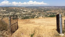 A hillside view through a gate. View of hills through gates Royalty Free Stock Photo