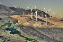 Hillside Wind Turbine Sunset-Sunrise. This wind turbine farm is at sunset located on a hillside in the Columbia River Gorge on the Washington State side of the Royalty Free Stock Image
