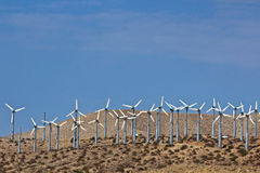 Hillside of wind turbines Royalty Free Stock Photography
