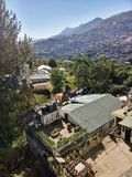 A hillstation with lovely houses, trees and mountains. View of Kohima from oyr hotel room during hornbill festival royalty free stock photography