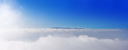 Hilltop. Above thick white clouds royalty free stock photos