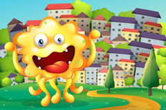 A hilltop across the tall buildings with a happy yellow monster Royalty Free Stock Photography