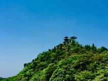 Hilltop ancient pavilion in spring day royalty free stock images