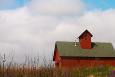 Hilltop Barn. Red barn on flowered hilltop, taken in the Spring stock images