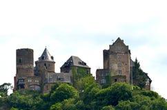 A hilltop castle against a cloudy sky. stock images