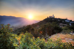 Hilltop church sunset Stock Photo