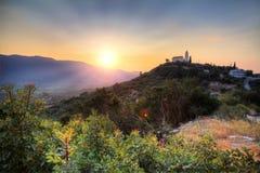 Hilltop church sunset Stock Photo